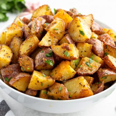 bowlfulserving bowl of garlic parmesan roasted red potatoes