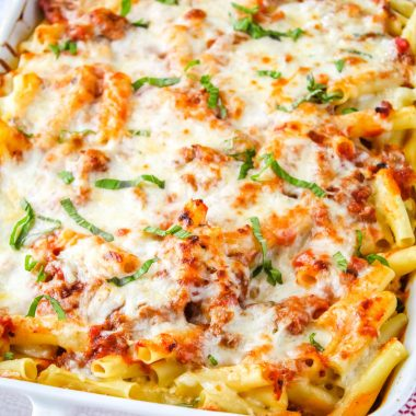 square image of baked ziti in a casserole dish