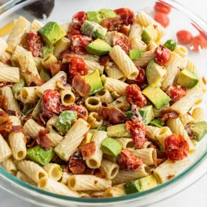 close up of bacon avocado pasta salad in a bowl