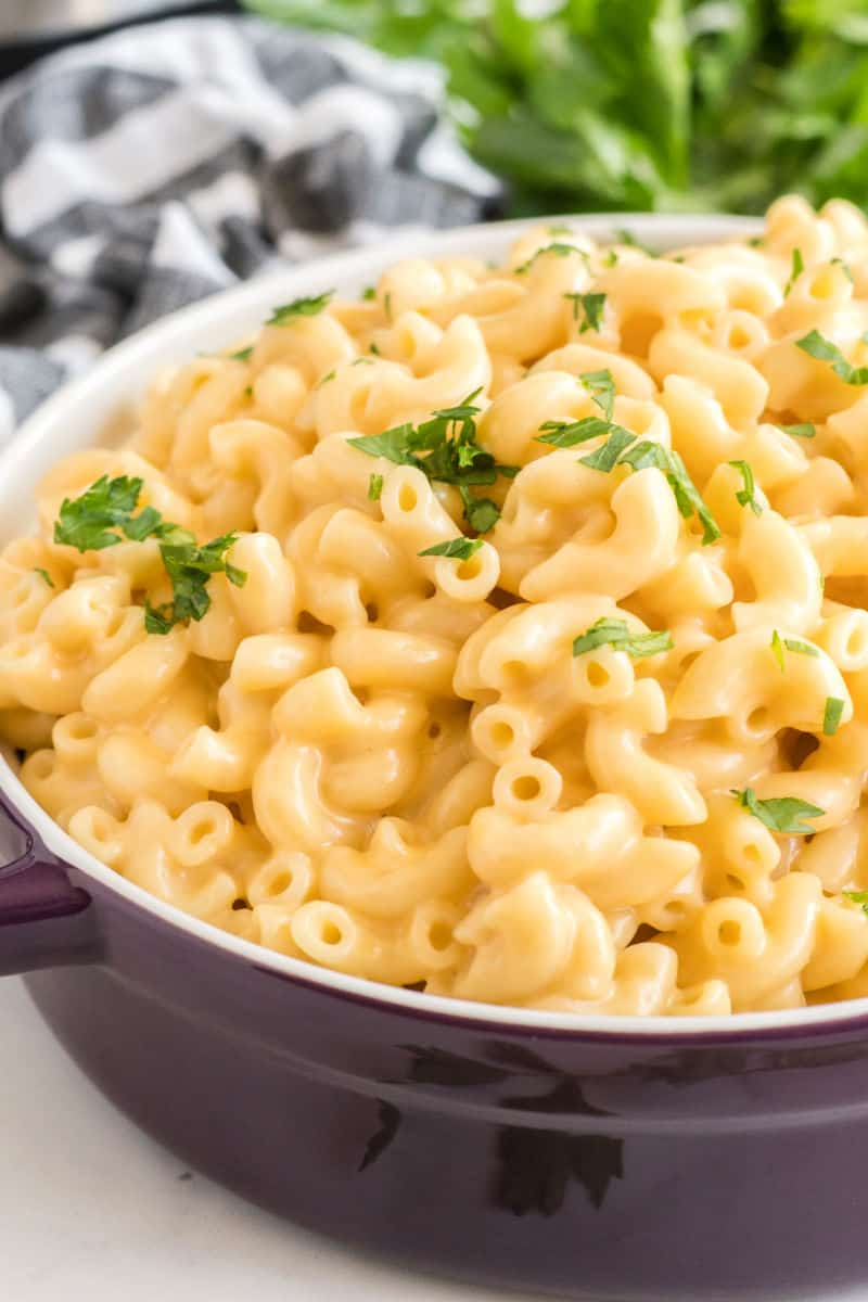 serving bowl of instant poc mac and cheese with chopped parsley on top