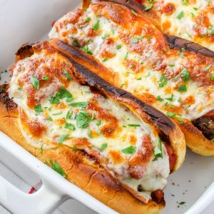 square image of meatball subs with parsley
