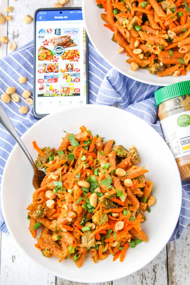 thai peanut sauce skillet pasta served in pasta bowls next to a phone shopping the Albertsons app