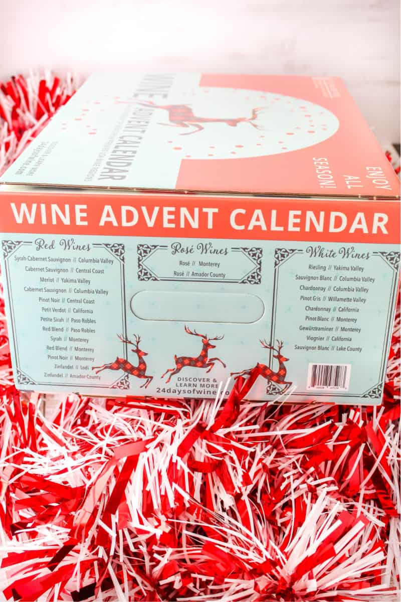 side of wine advent calendar box showing varietals included and state each wine is from