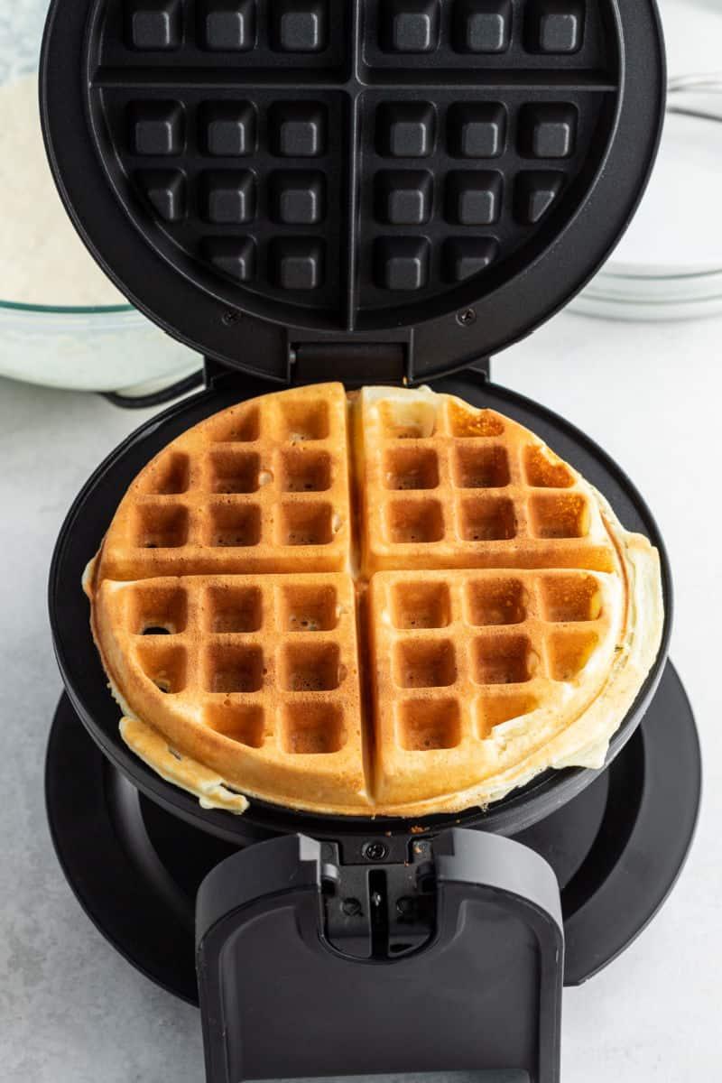 cooked waffle on a waffle iron