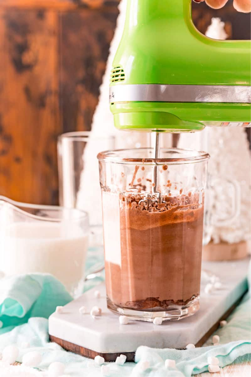 whipped hot chocolate in mixing glass with hand mixer