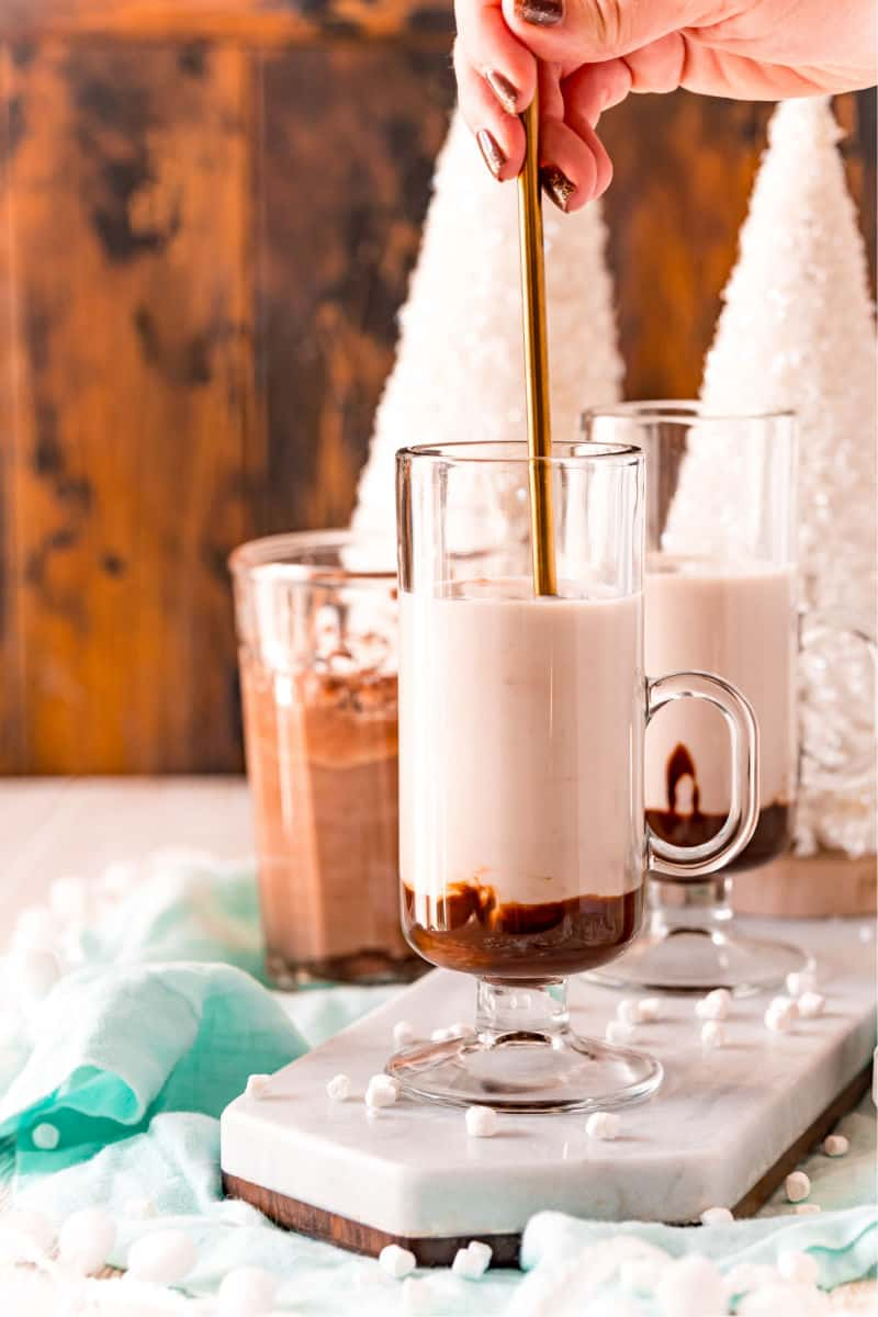 iced tea spoon in a drinking glass with chocolate syrup and milk