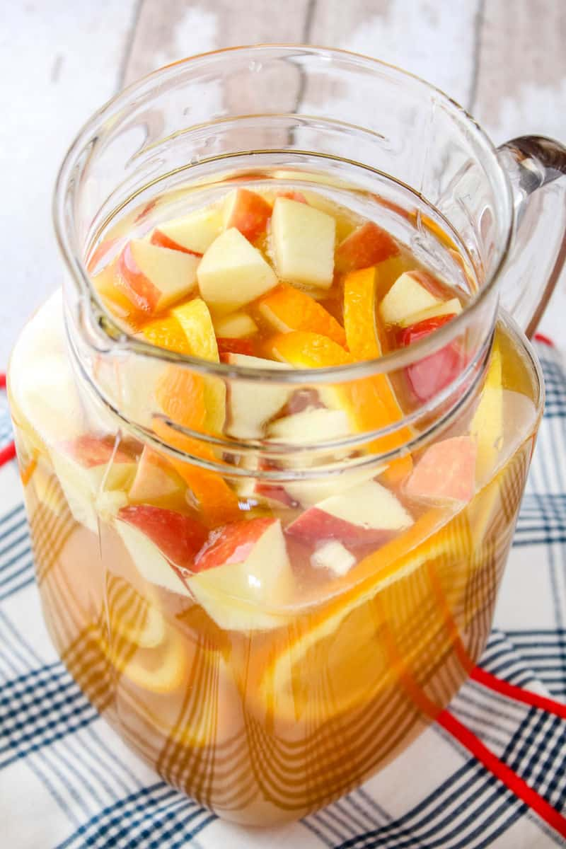 apple cider whiskey punch in a pitcher with fruit