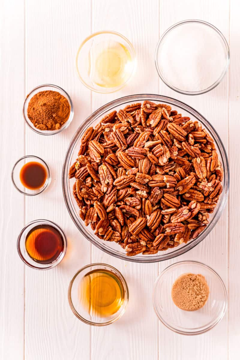 ingredients to make crockpot maple bourbon candied pecans in bowls on a table