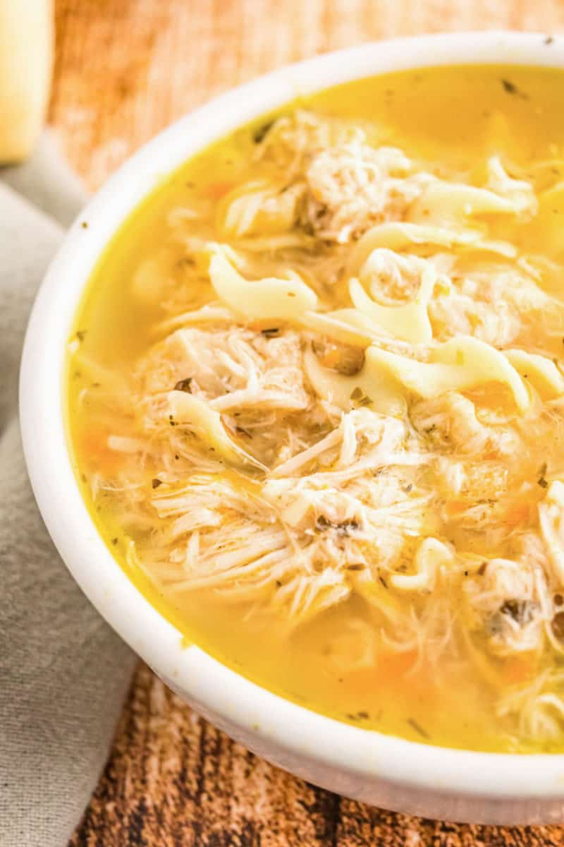 close up of chicken noodle soup in a bowl