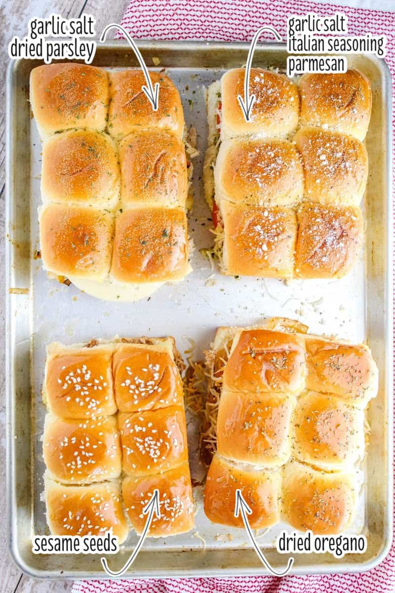 looking down at four types of chicken sliders on a baking sheet with seasonings listed