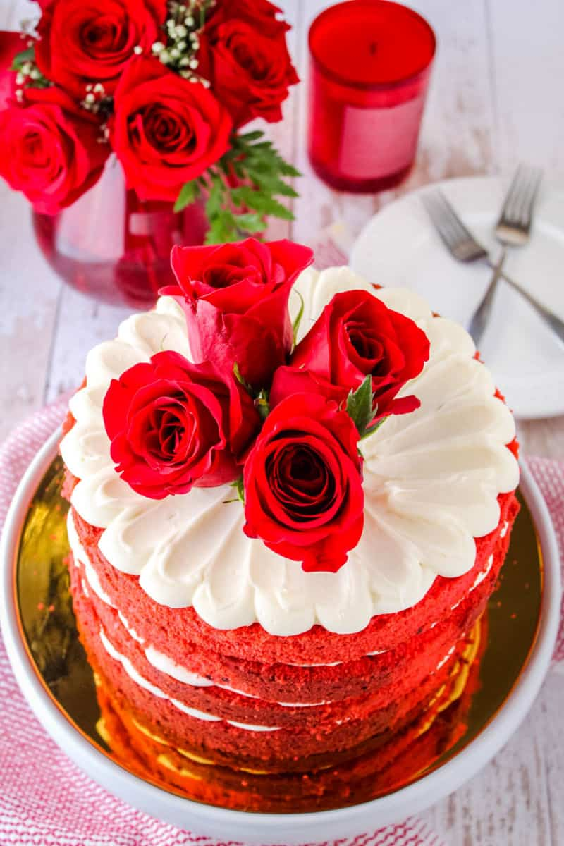 red velvet cake topped with fresh roses