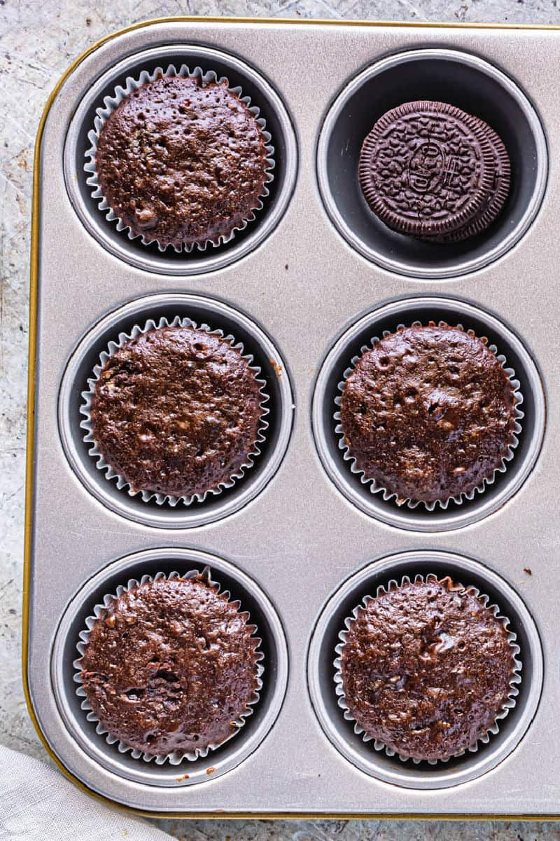 baked chocolate oreo cupcakes in a muffin tin