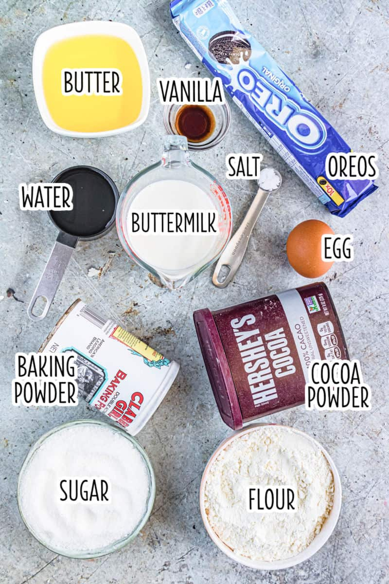 ingredients to make chocolate oreo cupcakes laid out on a countertop with text labels'