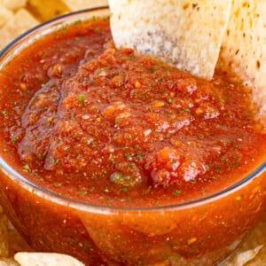 square close up image of a bowl of blender salsa