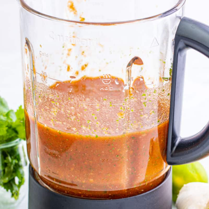 square side view image of salsa in a blender
