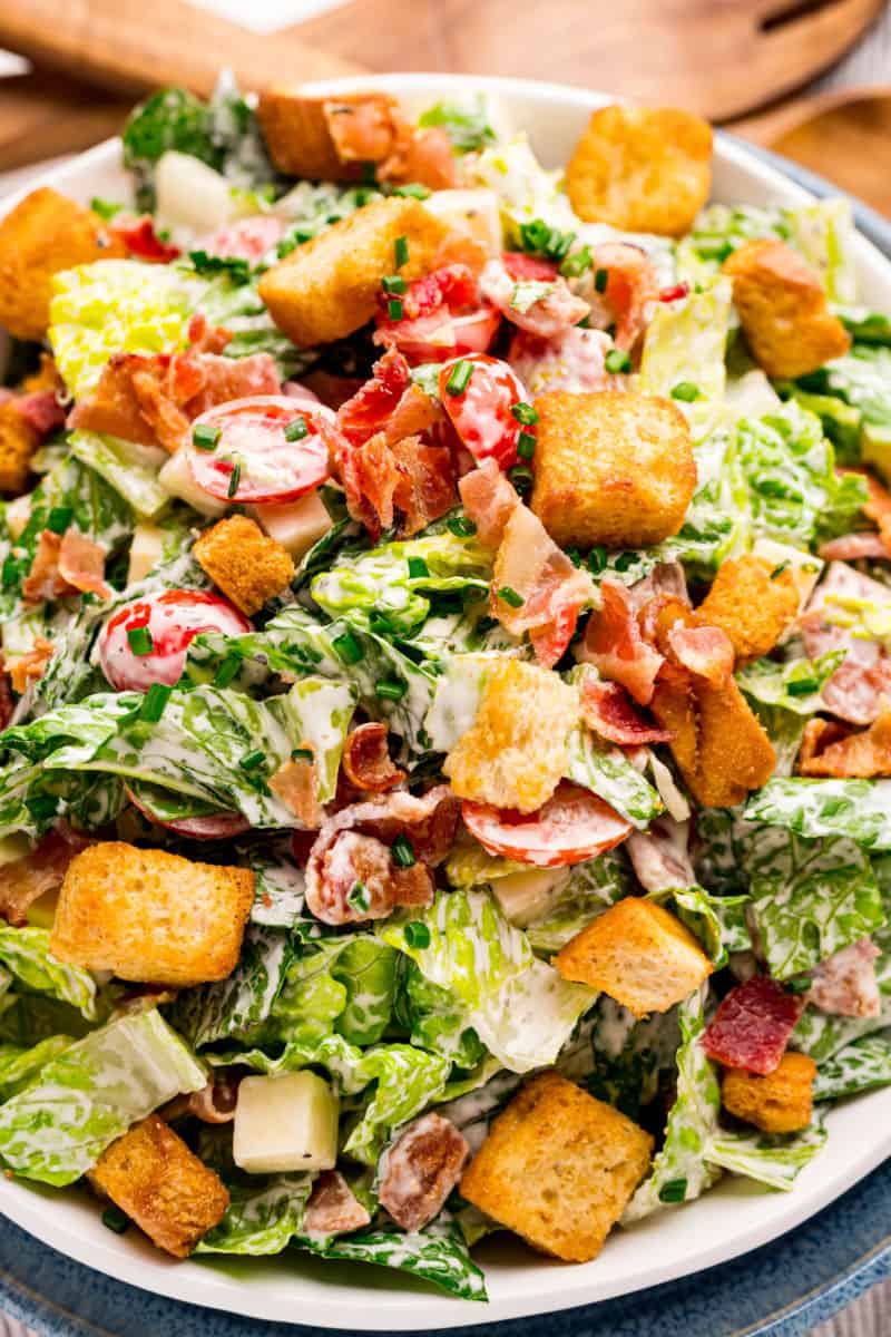 close up of BLT salad on dinner plates