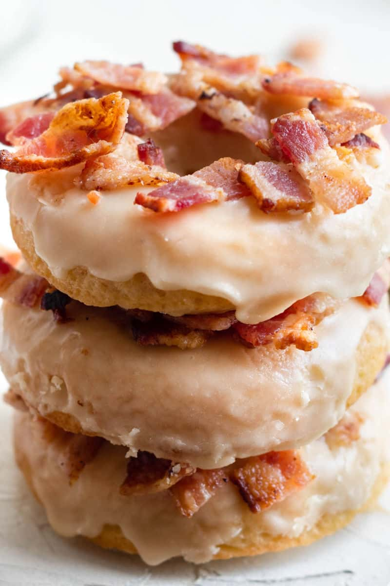 looking down at a stack of three maple bacon donuts