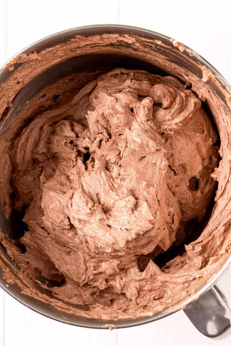 chocolate pudding forsting in a stand mixer bowl after beating until fluffy