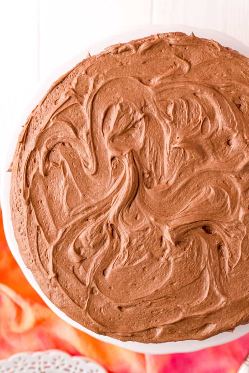 looking down at a cake with chocolate pudding frosting swirled swirled on top