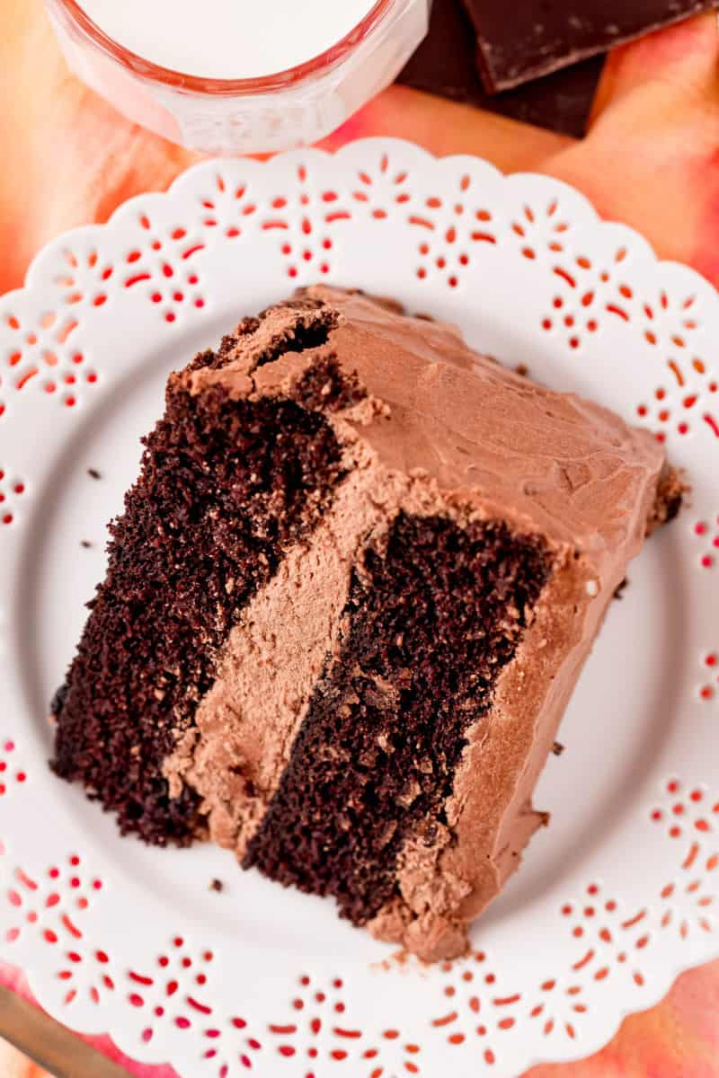 sliced of chocolate cake with chocolate pudding frosting on a small plate