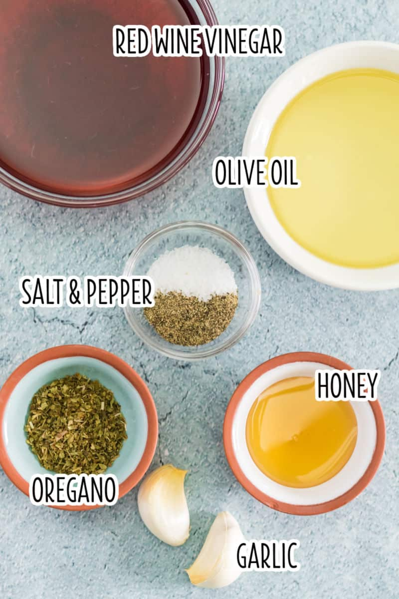 antipasto pasta salad dressing ingredients in bowls with text labels