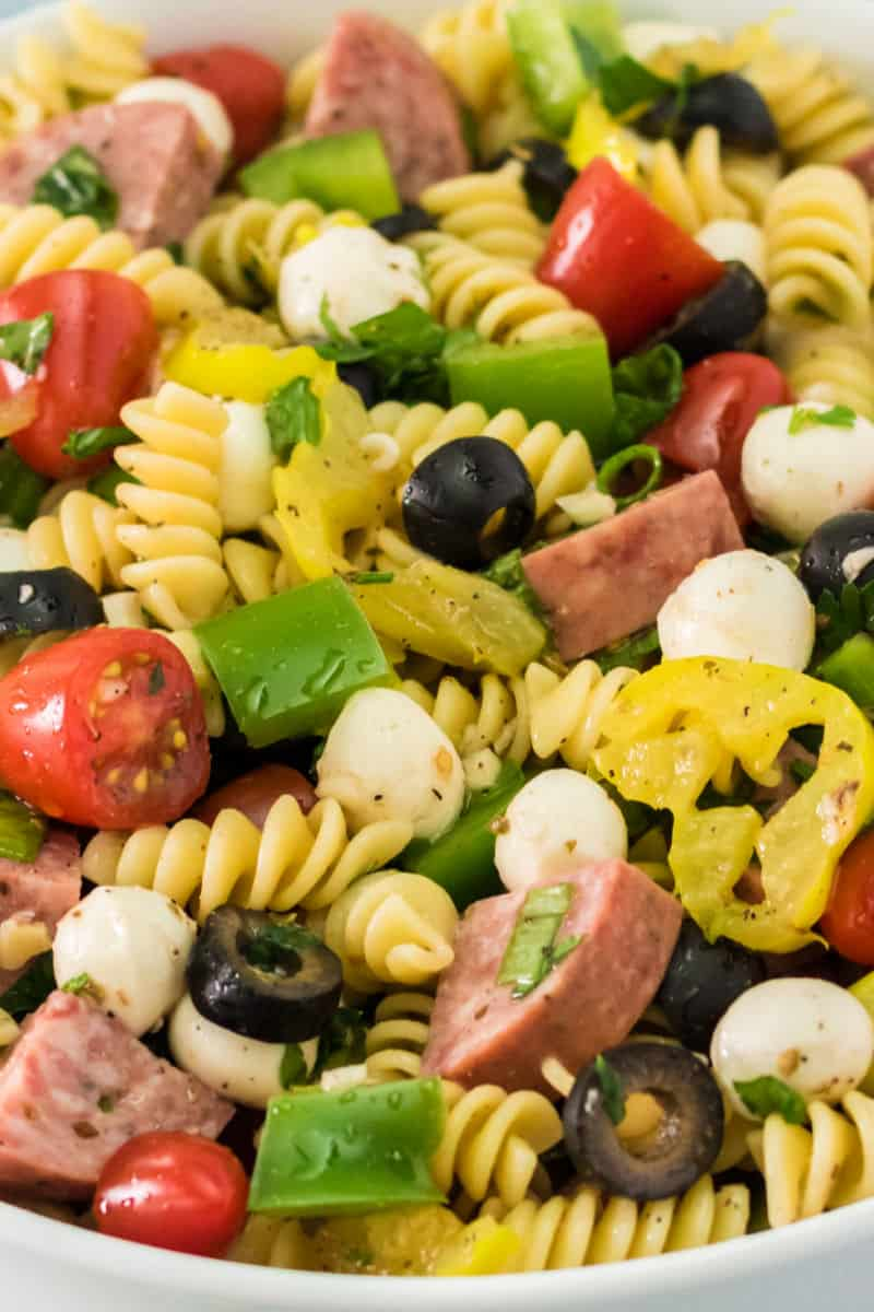 close up of antipasto pasta salad in a serving bowl