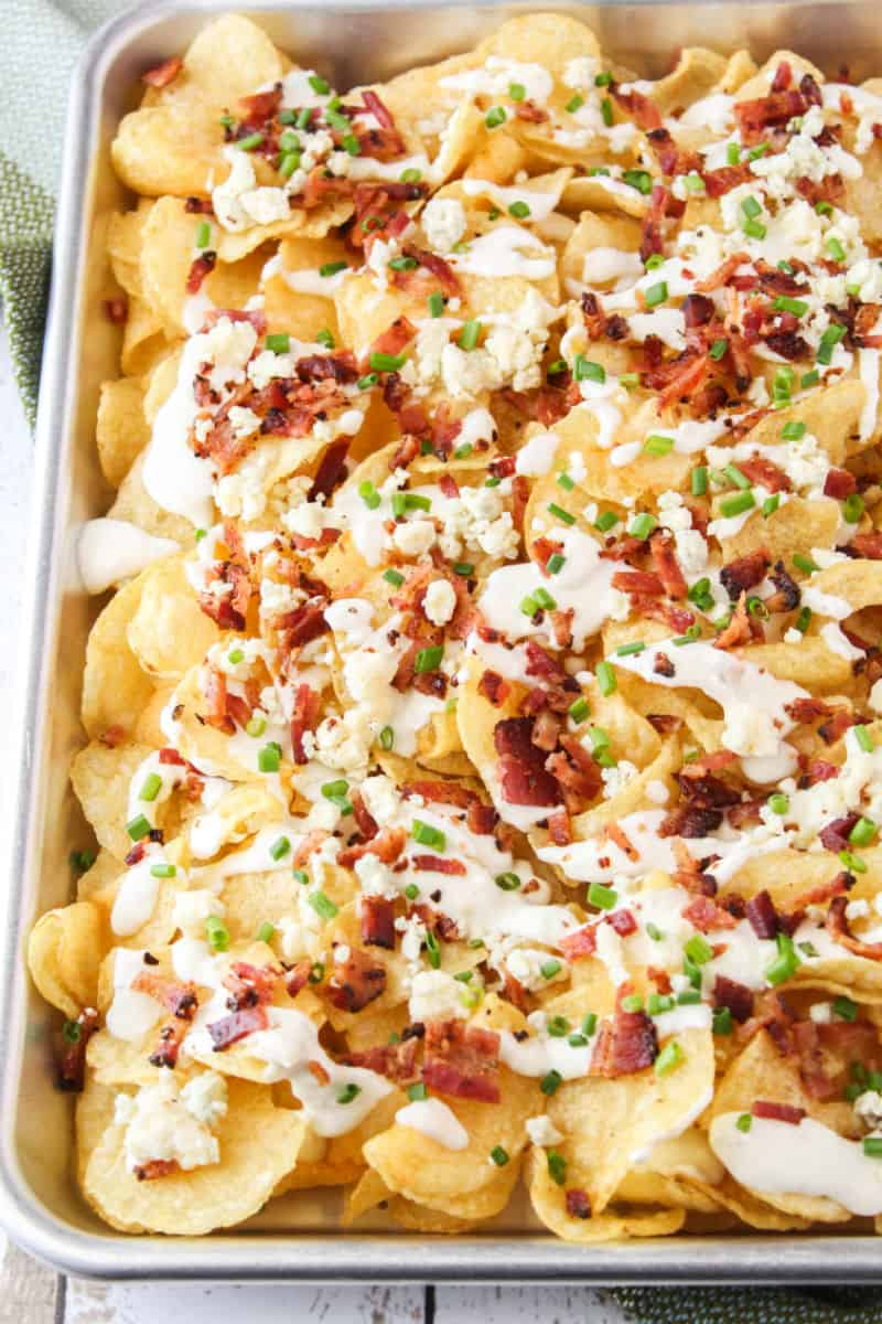potato chip nachos with blue cheese and bacon on a sheet pan