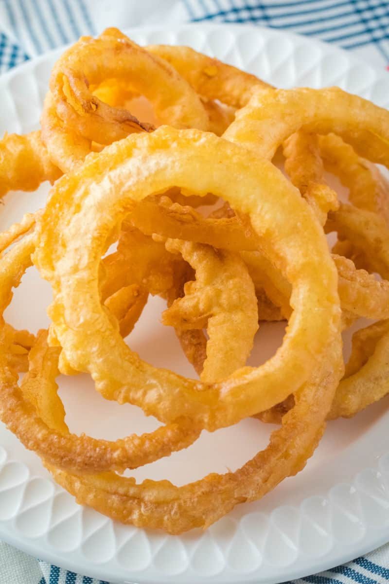 onion rings piled up on a plate
