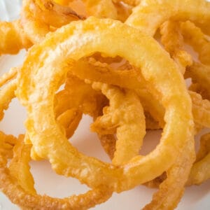 square close up of crispy fried onion rings
