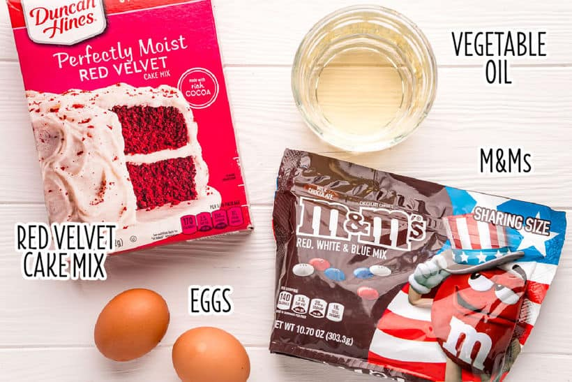 ingredients to make cake mix cookies on a counter with text overlay labels