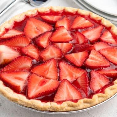 square close up of strawberry pie