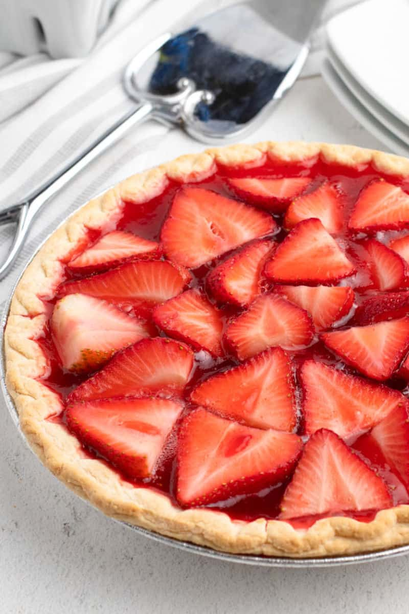 close up of a whole strawberry pie