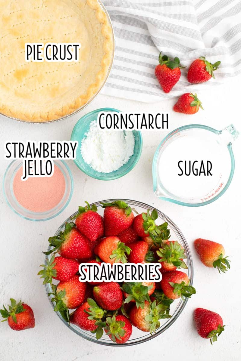 ingredients to make strawberry pie laid out on a counter with text labels