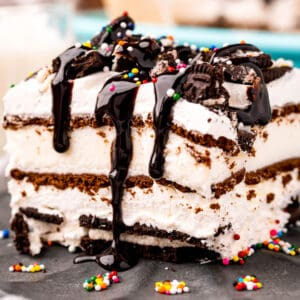 square image of oreo ice cream sandwich cake showing all the yummy layers