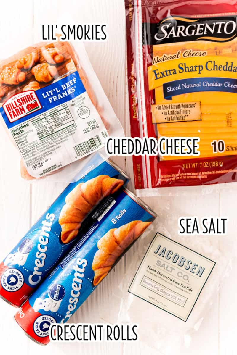 ingredients to make cheddar pigs in a blanket with text lables