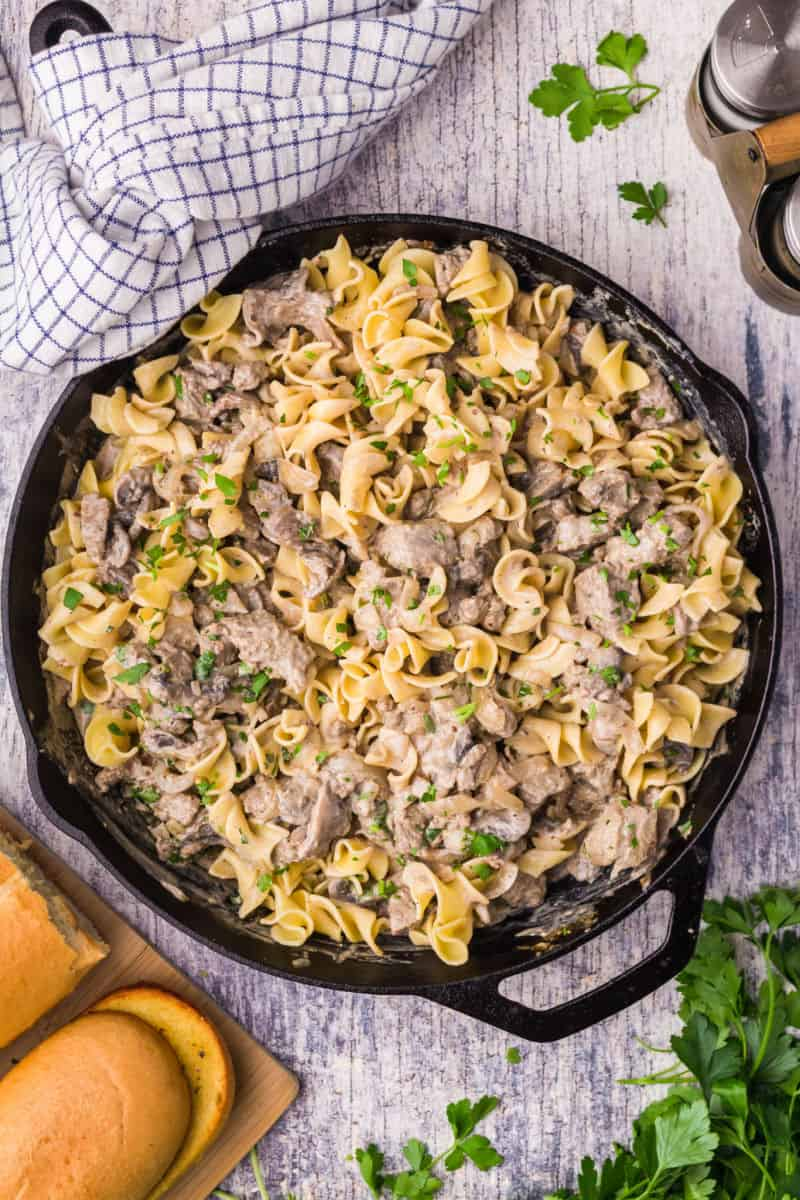 beef stroganoff in a skillet with egg noodles mixed in
