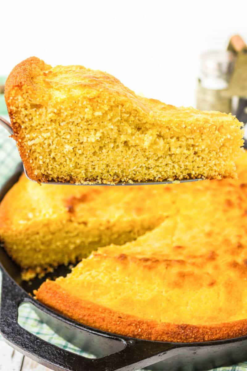 slice of skillet cornbread of a cake serve over the cast iron skillet