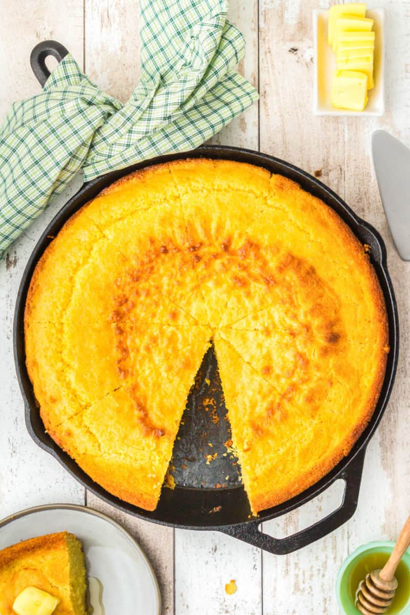 cast iron skillet cornbread cut into 10 pieces with one slice removed