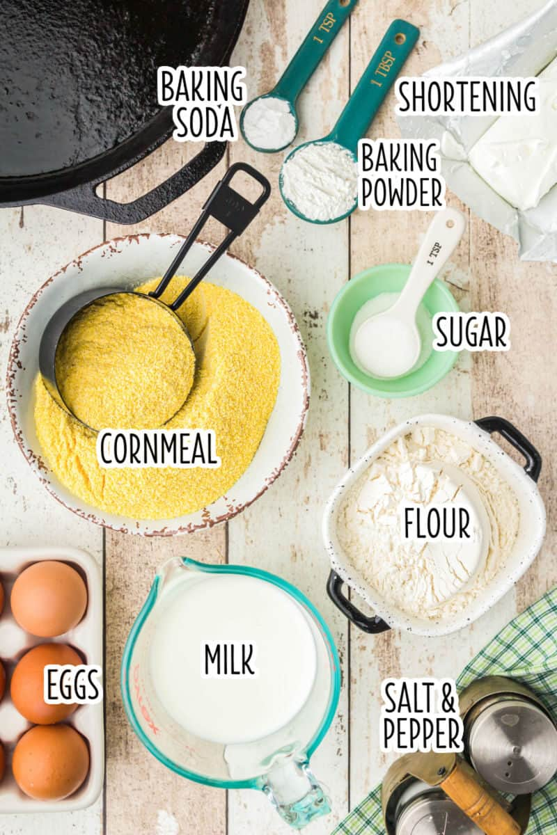 ingredients to make corn bread next to a cast iron skillet with text lables