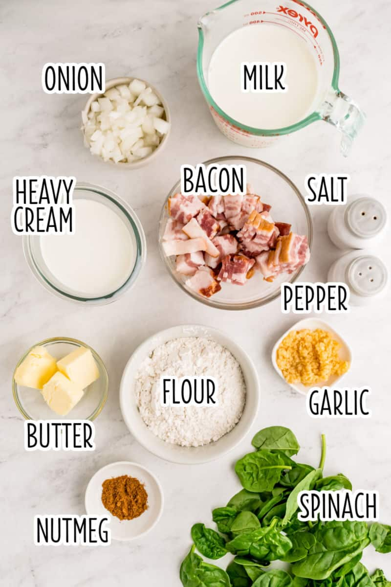 ingredients to make creamed spinach with bacon in bowls on a counter