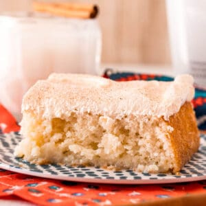 square image of rumchata poke cake on a dessert plate