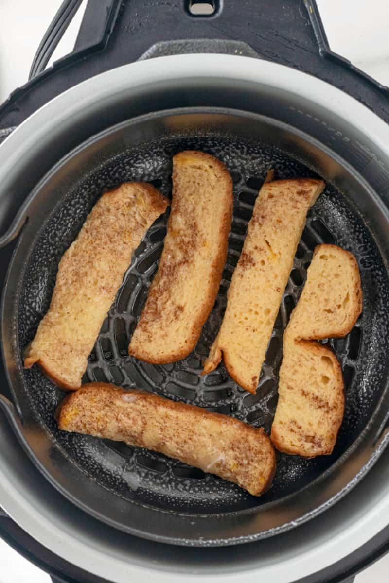 dipped bread sticks in an air fryer basket before cooking
