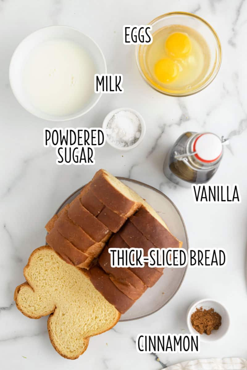 ingredients to make french toast in bowls on a counter with text lables