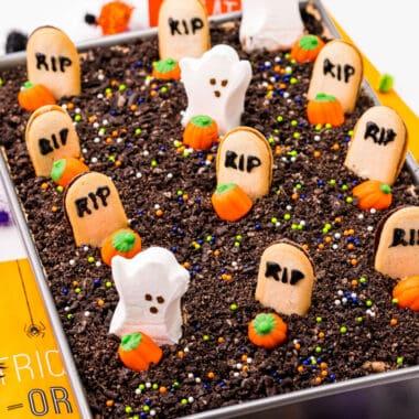 square image of halloween graveyard chocolate poke cake in a cake pan