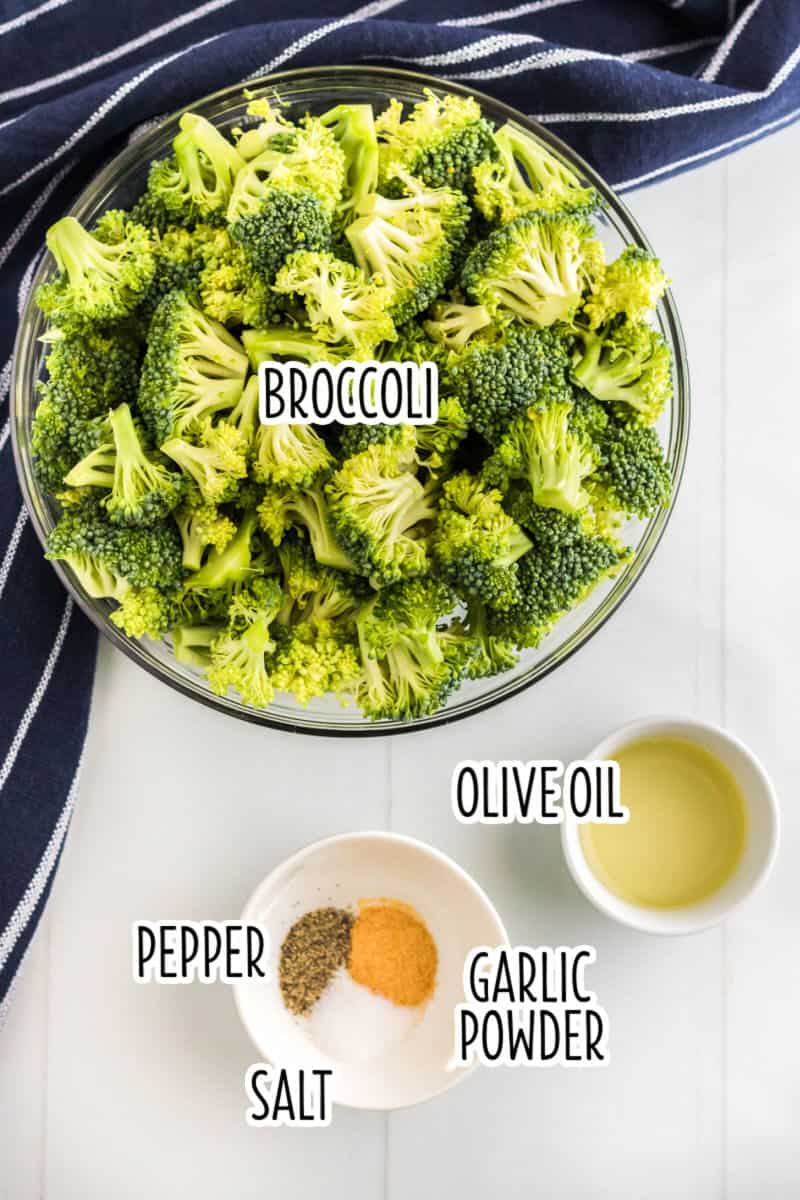 ingredients to make air fryer broccoli in bowls on a counter